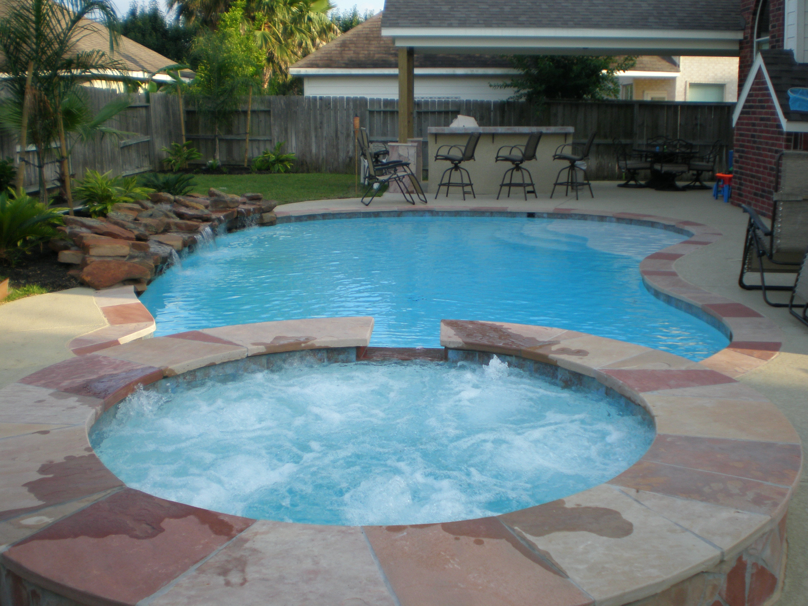 Huge landscape idea pools and landscaping ideas drought for Pool design with hot tub